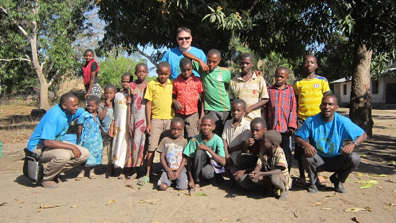 Village children with Country Director Bonus Caesar, Finance Director Victor Mwenda and ED Daniel Donovan